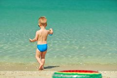 Two year old toddler playing on beach. Two year old toddler boy playing with beach toys on beach Stock Photos