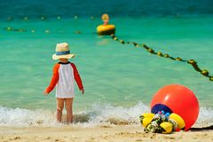Two year old toddler boy walking on beach. Two year old toddler boy in sun hat walking on beach Royalty Free Stock Photography