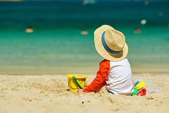 Two year old toddler playing on beach. Two year old toddler boy playing with beach toys on beach Stock Photography