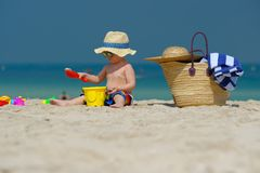 Two year old toddler playing on beach Royalty Free Stock Photo