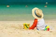 Two year old toddler playing on beach royalty free stock photos