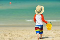 Two year old toddler playing on beach. Two year old toddler boy playing with beach toys on beach Royalty Free Stock Photo