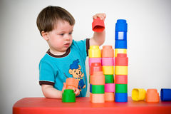 Two years child with colorful construction set Stock Photos