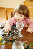 Two-years child eats mussels Stock Photography
