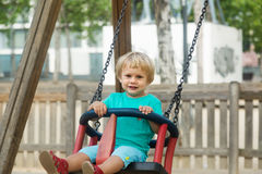 Two years child on swing Stock Image