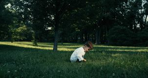 Two years old baby boy playing in park. Red EPIC