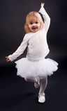 2 years old girl dancing in white Stock Photo