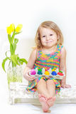Two years old girl holding Easter eggs carton. Two years old girl is holding Easter eggs carton Royalty Free Stock Photos