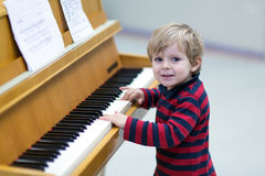 Two years old toddler boy playing piano Stock Photos