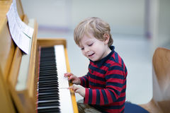 Two years old toddler boy playing piano Stock Images