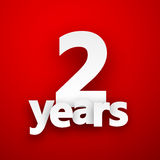 Two years paper sign. Two years paper sign over red. Vector illustration Stock Images