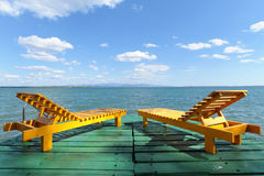 Two yellow armchairs and the horizon Stock Image