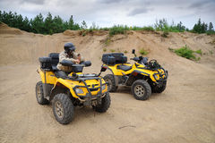 Two yellow ATV stock photography