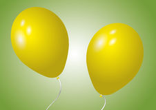 Two yellow balloons Stock Image
