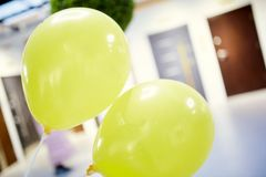 Two yellow balloons royalty free stock photography