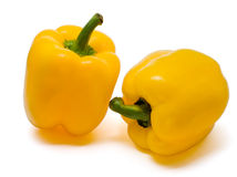 Two yellow bell peppers. Isolated  on a white background Stock Photos