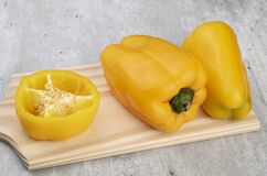 Free Two Yellow Bell Peppers And Half Pepper Over Wooden Board Royalty Free Stock Photography - 213676507