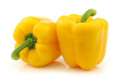 Two yellow bell peppers (capsicum) Royalty Free Stock Images