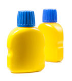 Two yellow bottles with paint isolated on white background Royalty Free Stock Photo