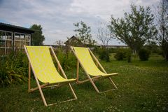 Two yellow chairs in the summer green garden for relax stock photo