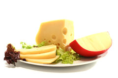Two yellow chunk of cheese and sliced Stock Photos