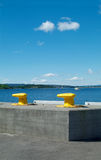 Two yellow cleats. With a view of the Oslofjord, Norway Stock Photo