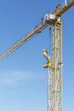 Two yellow construction cranes Royalty Free Stock Photography