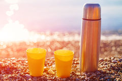 Two yellow cups on a sunny beach Royalty Free Stock Photos
