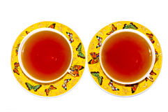 Two yellow cups of tea Stock Photography