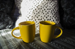 Two yellow cups of tea. ! royalty free stock photography