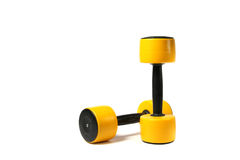 two yellow dumbbells Royalty Free Stock Images