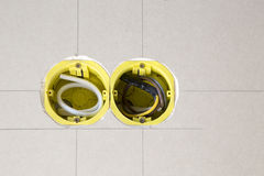 Two yellow electrical sockets. Installed in drywall Stock Photo