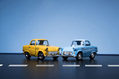 Two Yellow fifties toy model cars. Two Classic fifties scale model toy cars from front view Stock Images