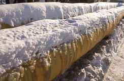 Two yellow frozen pipes in winter closeup Royalty Free Stock Photos