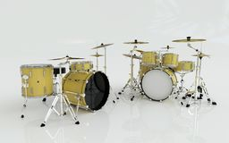 Two yellow or gold drums set in the white room Stock Photography