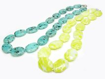 Two yellow and green colored beads Royalty Free Stock Photography