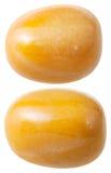 Two yellow jasper gemstones isolated Stock Photography