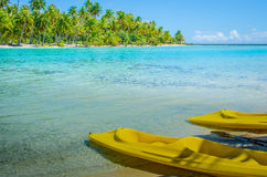 Two yellow kayaks on the shore Stock Photo
