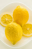 Two yellow lemon on a  white background Stock Photos