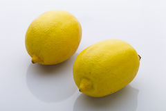 Two yellow lemon on a white background Royalty Free Stock Images