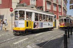 Two yellow Lisbon trams Stock Photos