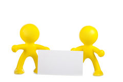 Two yellow little men hold a white banner Royalty Free Stock Photo