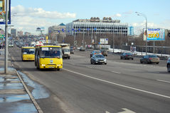 Two yellow minibuses moving on the allocated strip on Volokolamskoye Highway. Moscow Stock Photography