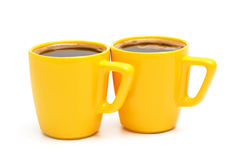 Two yellow mugs Royalty Free Stock Photography