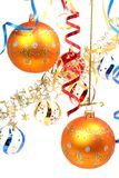 Two yellow New Year's spheres on a background of a tinsel Royalty Free Stock Photos