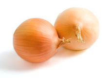 Two yellow onion bulbs. Isolated on a white background Royalty Free Stock Photos