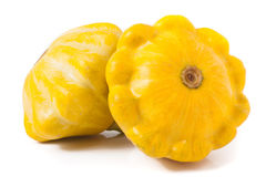 Two yellow pattypan squash isolated on white background.  Royalty Free Stock Images