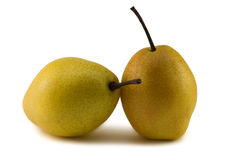 Two yellow pears on a white background. Fresh fruit Royalty Free Stock Images