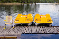 Two yellow pedalo on the resort lake Stock Images
