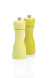 Two yellow pepper mills Royalty Free Stock Photo